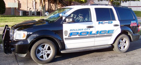 A police K-9 SUV parked on a city street