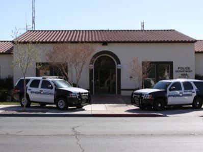 2 Police SUVs parked on the sidewalk in front of the Boulder City Police Department.