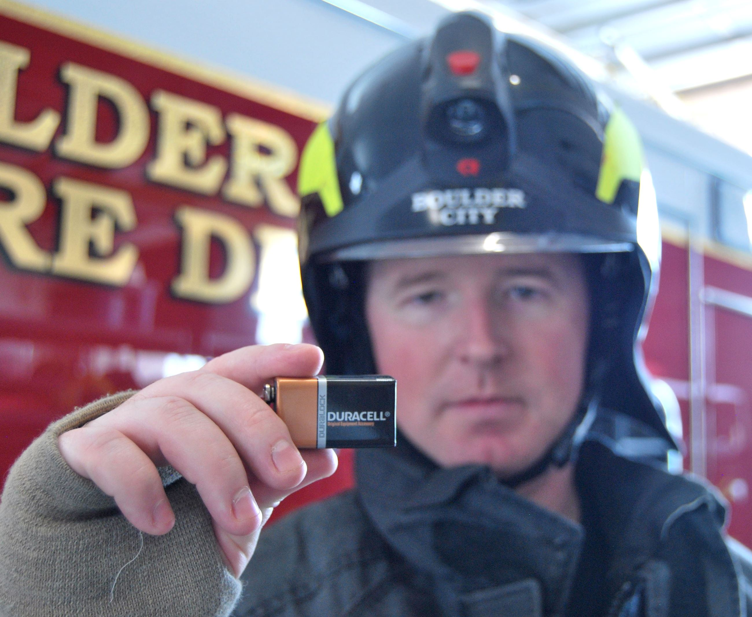 Firefighter holds a battery