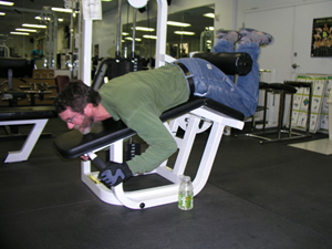 A man in denim jeans uses the leg curl machine at the Fitness Center