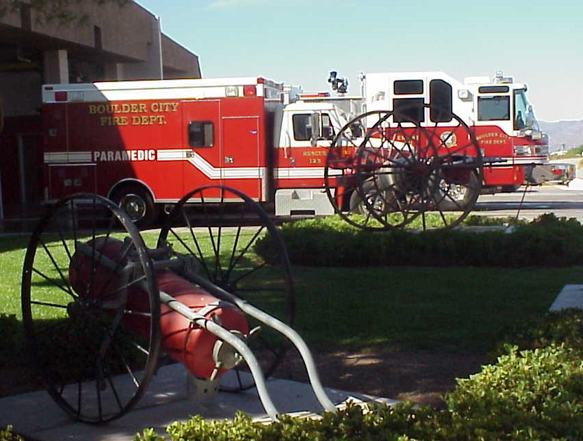 A fire truck and a paramedic response vehicle parked next to a fire station